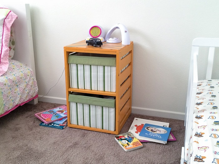 Before of the kids room with old nightstand and books
