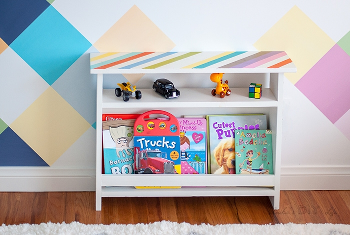 Colorful kids bedside table with book storage and toys