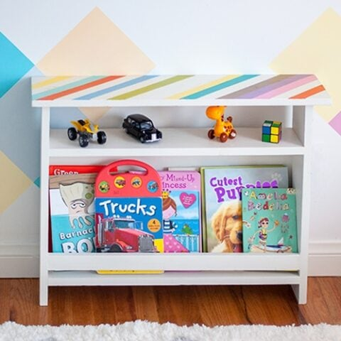 This DIY Kids bedside table combines function and style. This kids furniture has book storage for easy access to bedtime reading. Add organization to the kids' room with this easy beginner woodworking project!