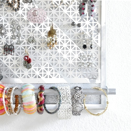 Make a DIY jewelry organizer to organize and display all your jewelry. This DIY wall jewelry organizer is easy to make with a few supplies. The perfect way to display bracelets, earrings, and necklaces with this hanging jewelry organizer.