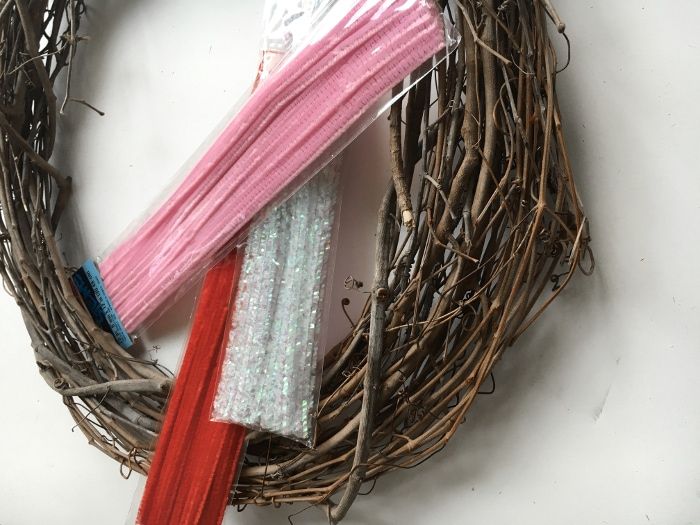 Make an easy DIY Valentine's wreath for under $5 and a reusable grapevine wreath