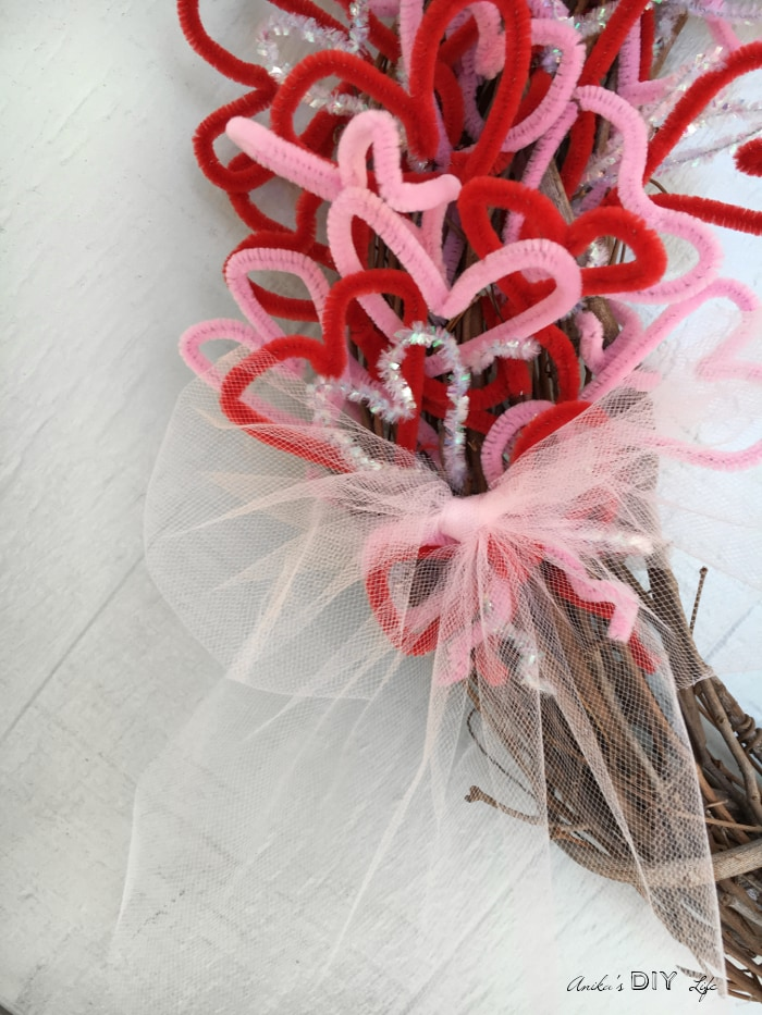 Finish a pretty and easy Valentine's wreath with a pretty bow