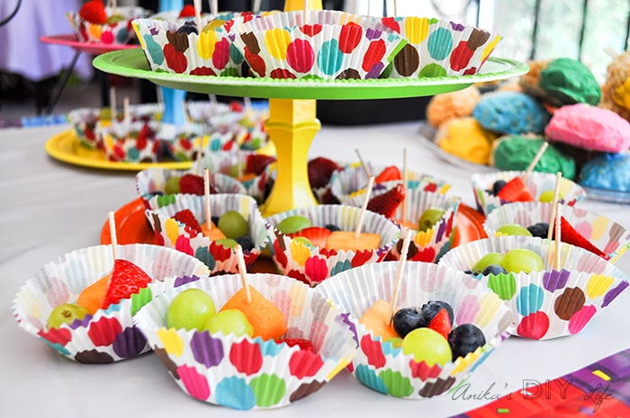 Little fruit bowls in cupcake liners. Fun colorful rainbow birthday food idea