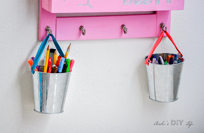 Close up of supply buckets hanging from the DIY desk organizer
