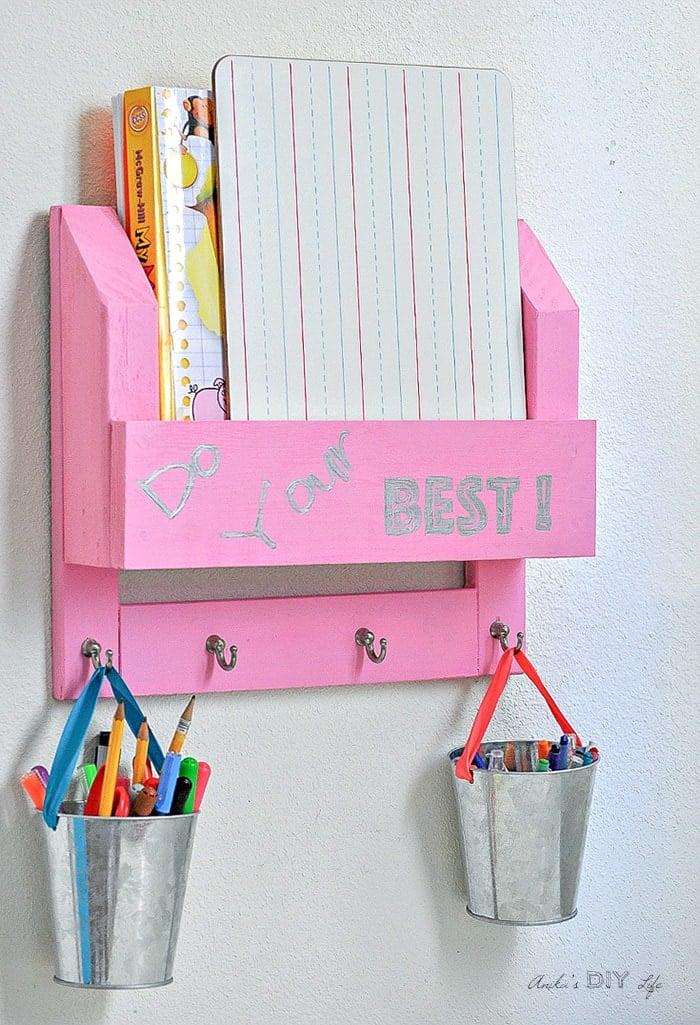DIY desk organizer with workbooks and paper s