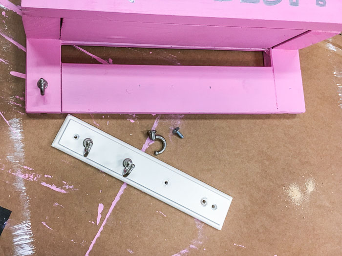 attaching hooks to the bottom of the DIY desk organizer
