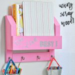 Scrap wood DIY desk organizer on the wall with text overlay