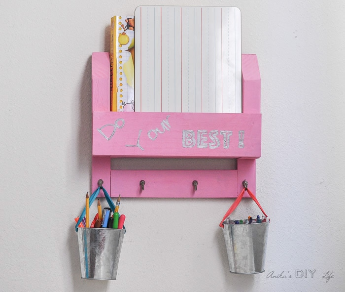 Easy DIY homework organizer on wall with books and pens