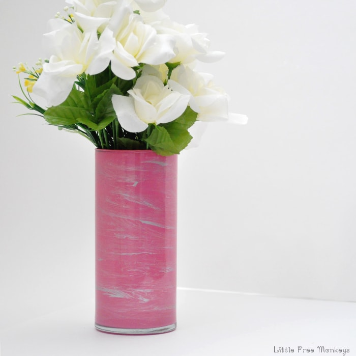 An easy DIY marbled vase made in 5 minutes! And it is water proof! You have to see it to believe it!
