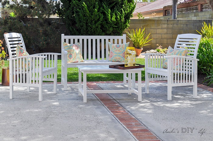white painted wood furniture in patio