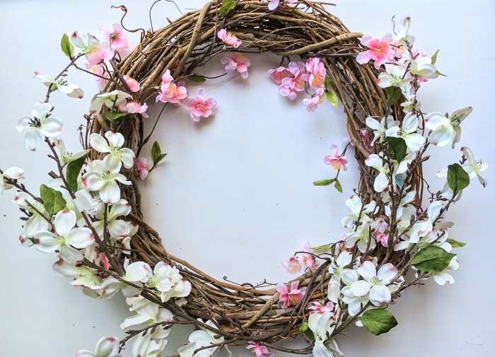 Make an easy and gorgeous DIY Spring wreath for under $15. Reuse a grapevine wreath for every season!