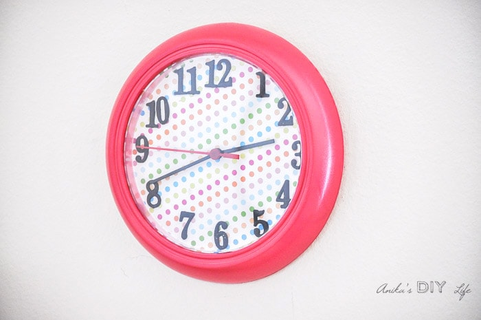 Ikea Rushc wall clock makeover with colored scrapbook paper