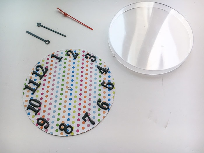 Ikea Rusch wall clock face made from scrapbook paper and clock numbers