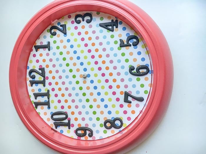 Ikea Rusch wall clock assembled with scrap book paper and numbers