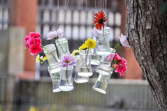 pretty spring decor with recycled glass bottles