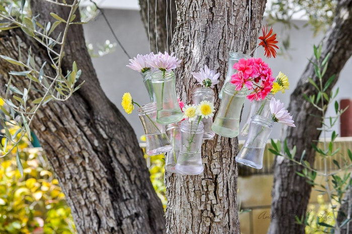make your own wind chime and outdoor decor with this recycled glass bottle decor idea
