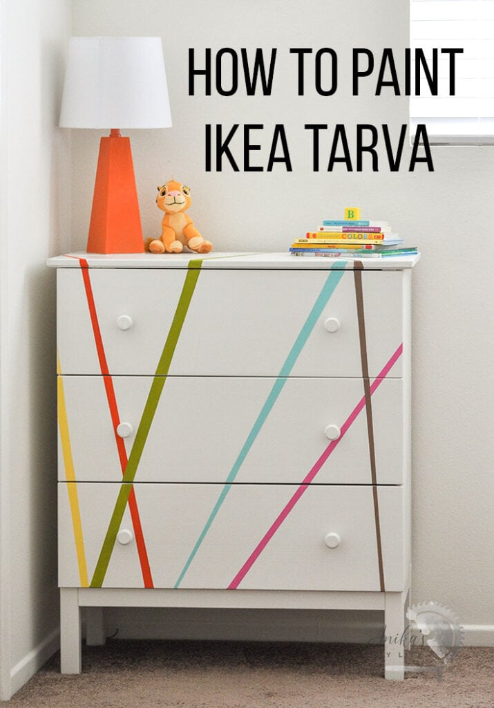 White painted  Ikea Tarva with colorful stripes and text overlay
