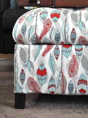 Make your own DIY upholstered storage ottoman. This step by step tutorial shows you how to build an ottoman with basic tools and how to cover an ottoman in fabric. Also includes DIY storage ottoman plans so you can make your own upholstered ottoman easily.