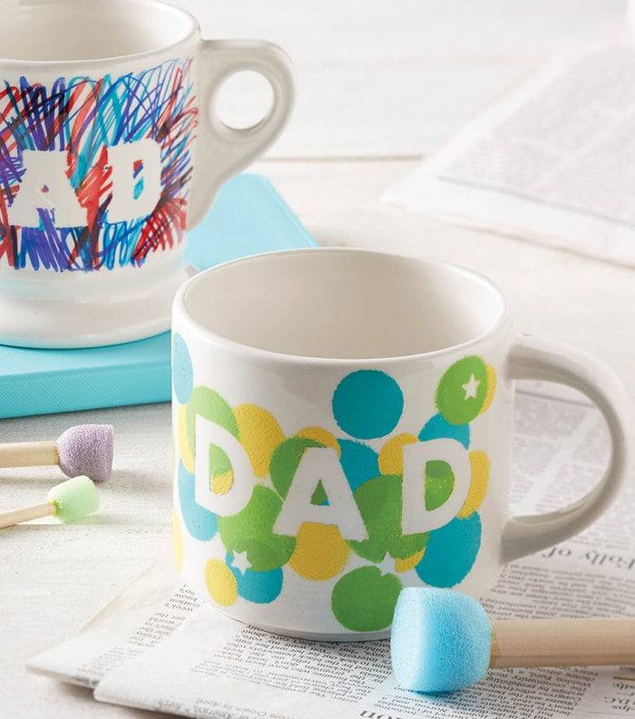 Mug with DAD written on it