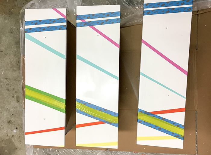 Colorful stripes painted on Ikea Tarva dresser drawers. with masking tape for next layer