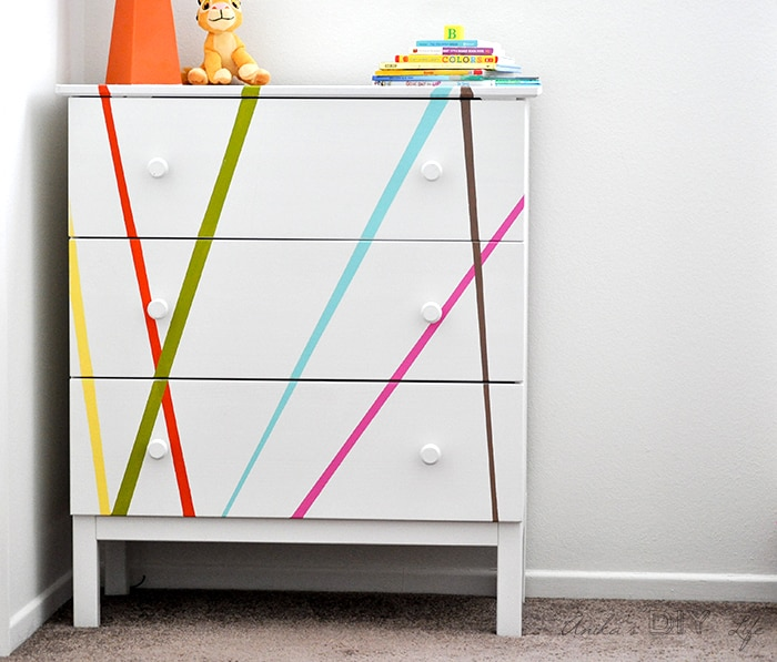 White Ikea Tarva makeover with colorful stripes in child's bedroom.