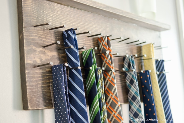 DIY wooden tie rack on wall with ties