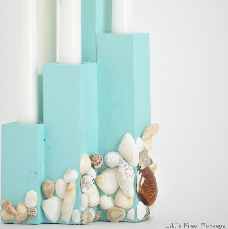 An easy DIY coastal candle holder that brings the right touch of beach to your decor and makes a great centerpiece!