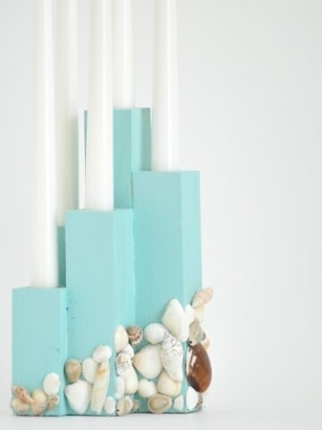 This DIY coastal candle holder brings the right touch of beach to your decor and makes a great centerpiece!