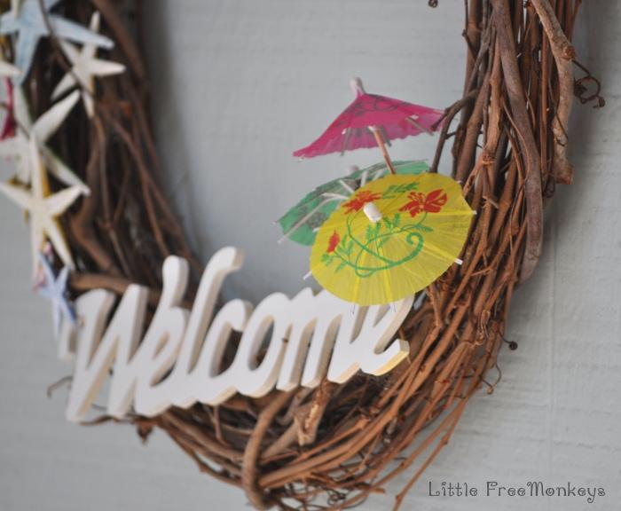 Painted sea stars and mini umbrellas to create this DIY coastal wreath