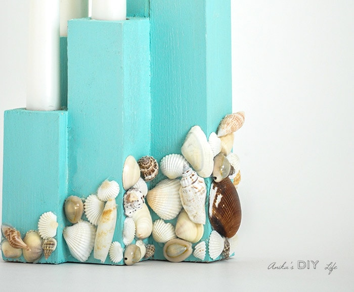 close up of DIY scrap wood candle holder with shells