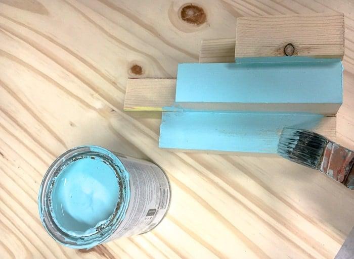Painting the aqua coastal DIY scrap wood candle holder