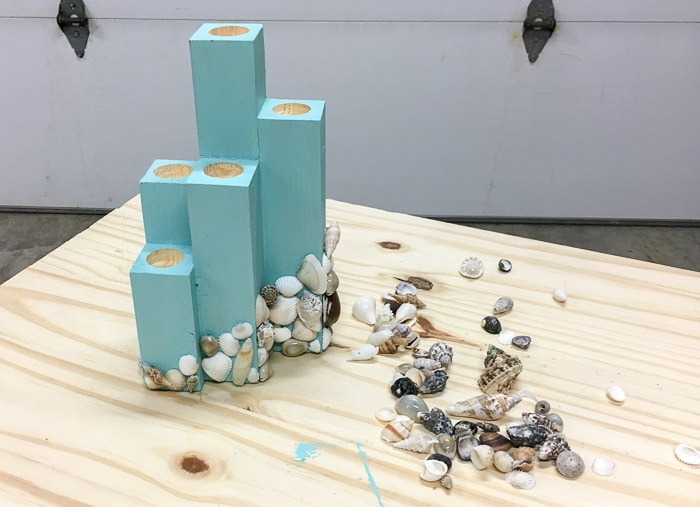 glueing shells to the DIY coastal candle holder