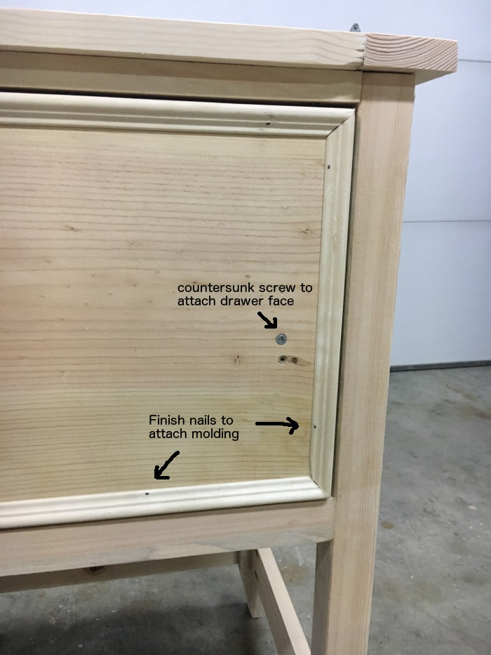 DIY Mirrored Console table- attach molding to the drawer faces