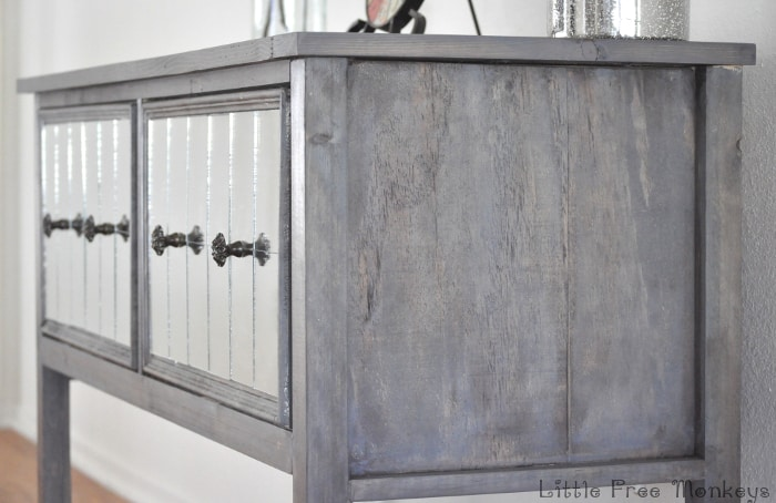 Build your own DIY mirrored console table! Step by step tutorial on how to build this amazing rustic weathered furniture