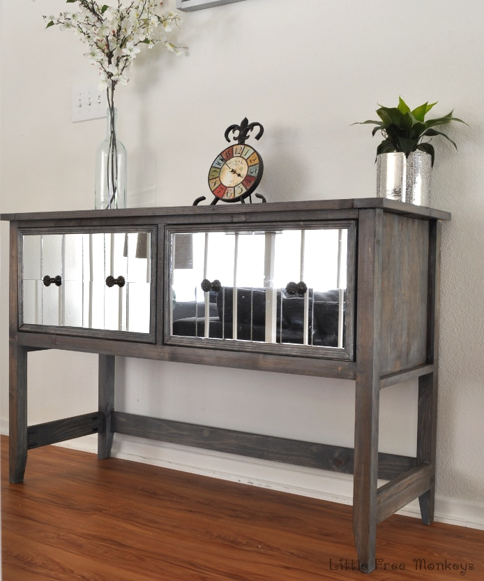 Build your own DIY mirrored console table! Step by step tutorial shows how easy it is to make this amazing high end looking DIY sideboard