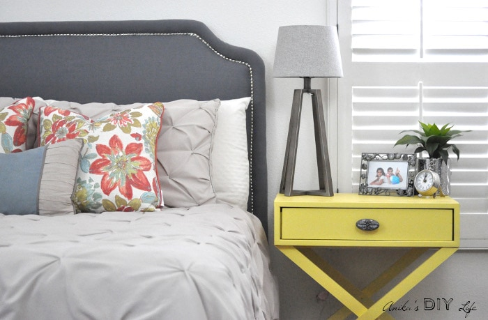 DIY Headboard with nailhead trim and DIY X-base nightstand! Take a look at this DIY Master bedroom decor