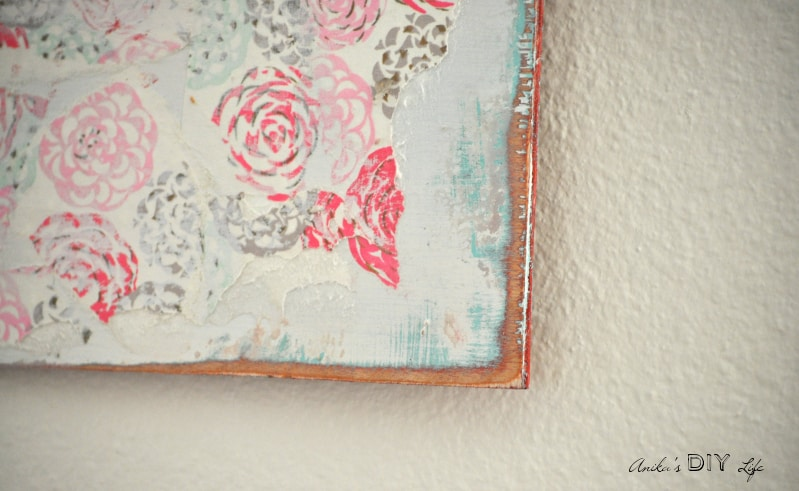 An easy DIY Wall art perfect for the bedroom! Layers of paint and pretty wrapping paper distressed for the most amazing effect.