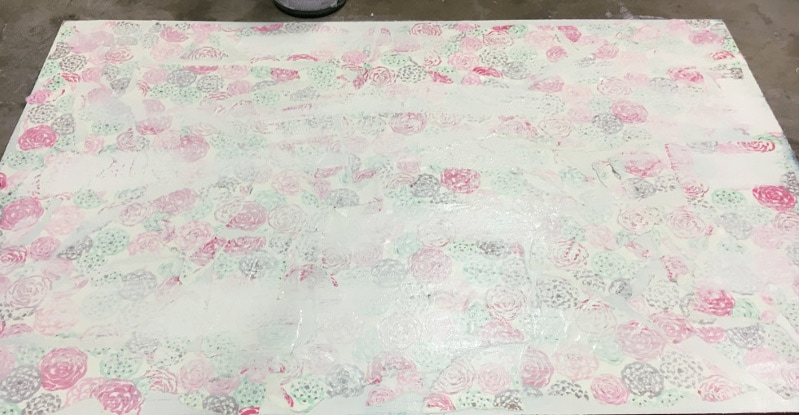 Decoupage pretty wrapping paper over layers of paint for a fun effect