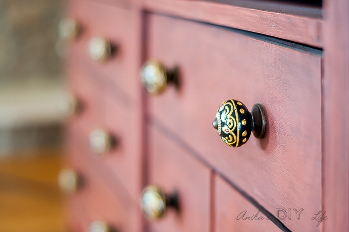 These knobs on the faux apothecary cabinet are just amazing!