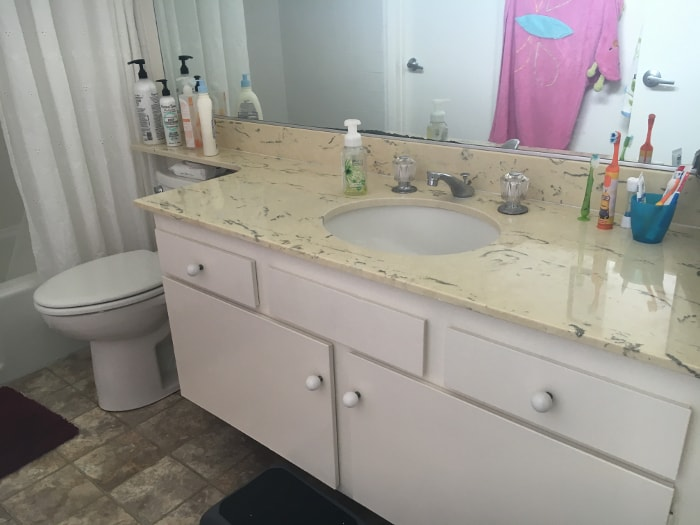 This vanity really needs an update! see how I did it for under $100 and it is all removable!