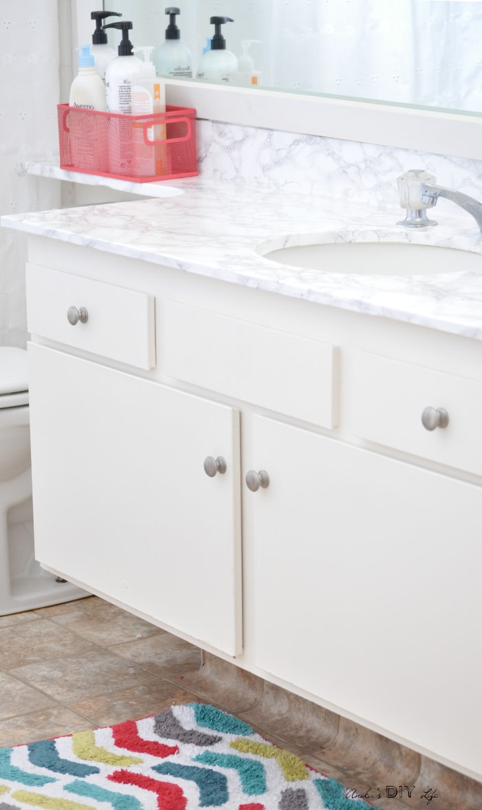 This contact paper countertop before and after will blow you away! It is the perfect budget-friendly solution for any rental bathroom and kitchen.