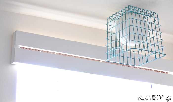 Super easy wood valence and basket lamp shade for kids bathroom makeover.