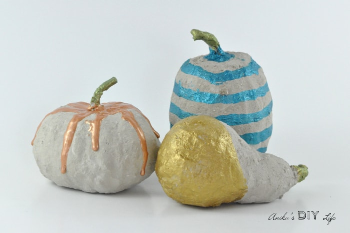 Paint dripped DIY concrete pumpkins - so easy to make!