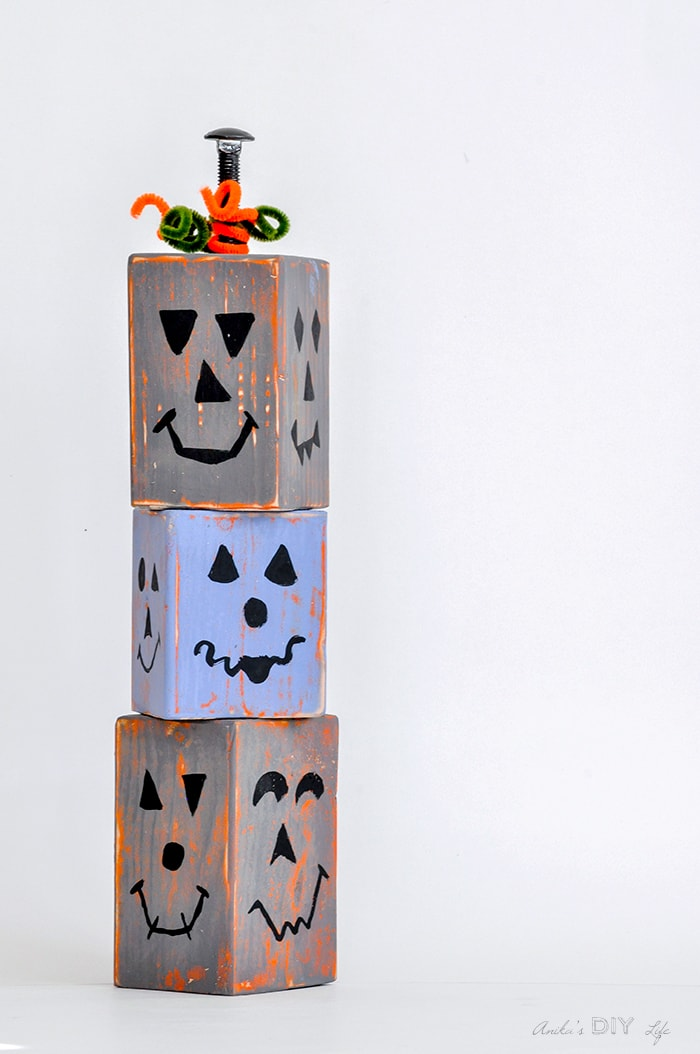 DIY wood block pumpkins that are stackable and distressed. Easy to make!