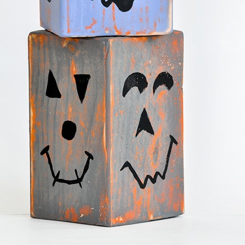 DIY Wood pumpkins that are distressed and stackable make perfect fall decor! Add a fun shabby chic vibe to your fall decor with wood block pumpkins!