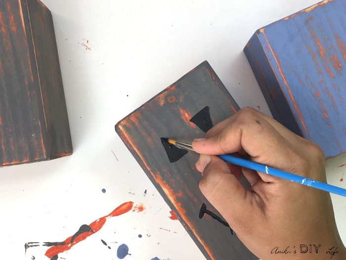Painting distressed DIY wood pumpkins
