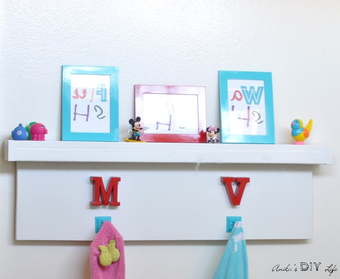 Easy to make DIY towel hooks and floating shelf that goes over the towel bar.