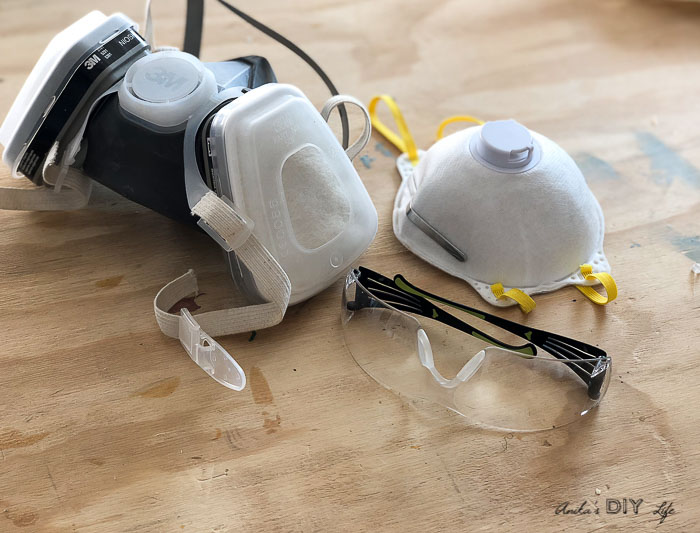 Ventilator, dust mask and safety glasses needed for protection while painting furniture
