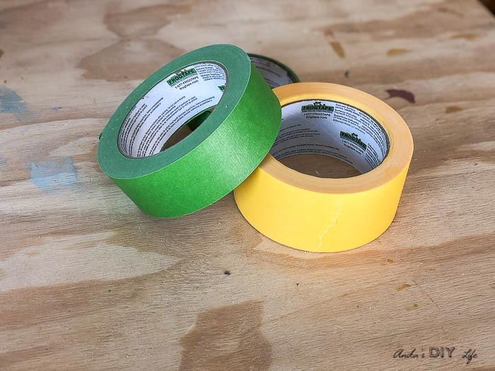 green and yellow frog tape on workbench