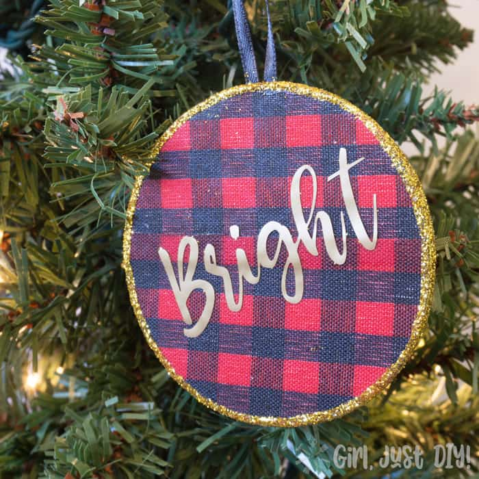 Red and blue plaid circular ornaments on Christmas tree